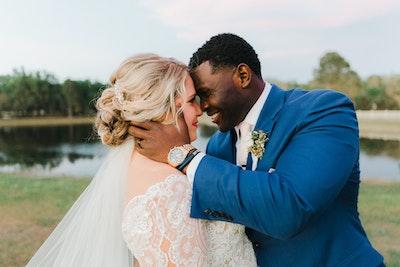 Mallory Dawn bride looking at groom