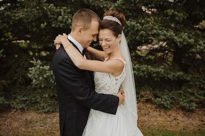 Taylor Lynette bride wearing a crown and hugging groom