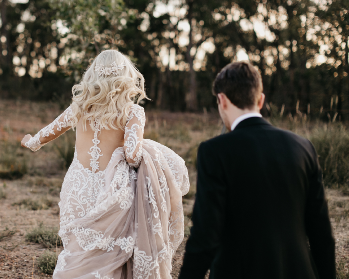 Groom with Real Bride Wearing Long Sleeve Mermaid Wedding Gown by Sottero and Midgley