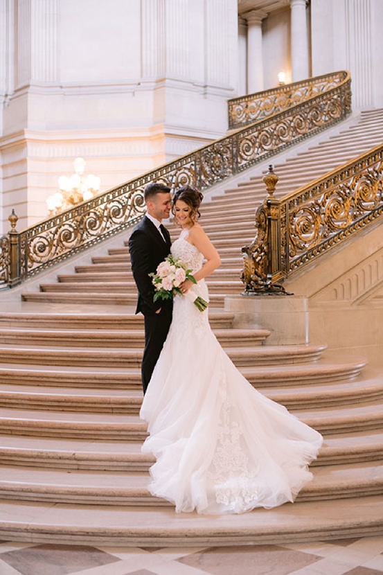 Groom With Real Bride Wearing Lace Mermaid Bridal Gown Called Alistaire by Maggie Sottero