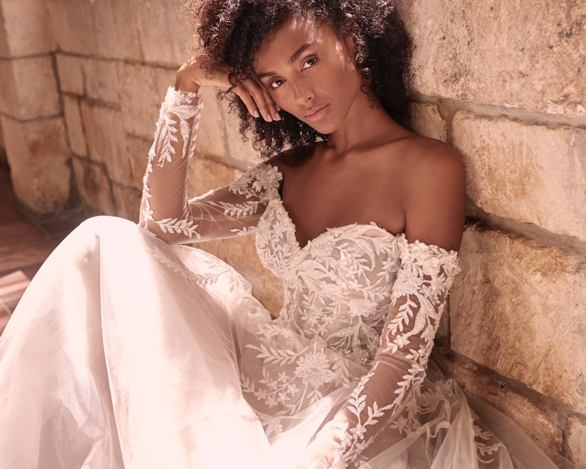 Model Wearing Lace Sheath Boho Wedding Dress Called Orlanda by Maggie Sottero