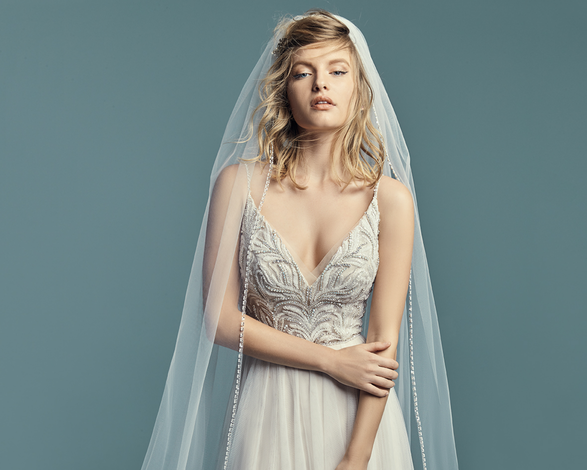 Model Wearing Boho A-line Wedding Dress Called Charlene by Maggie Sottero with Floor Length Beaded Bridal Veil