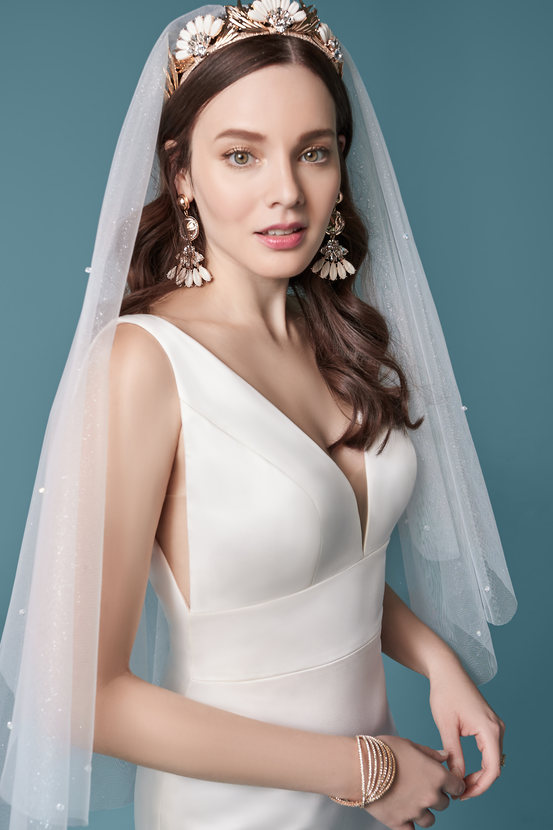 Model Wearing Minimalist Sheath Wedding Dress Called Anissa by Maggie Sottero with Sparkly Fingertip Veil