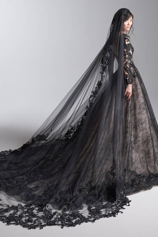 Model Wearing Black Ball Gown Wedding Dress Called Zander by Sottero and Midgley with Black Cathedral Veil.
