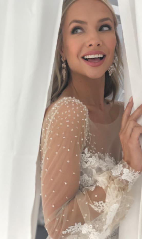 Model Wearing Vintage Edwardian inspired puff sleeve wedding dress during runway event