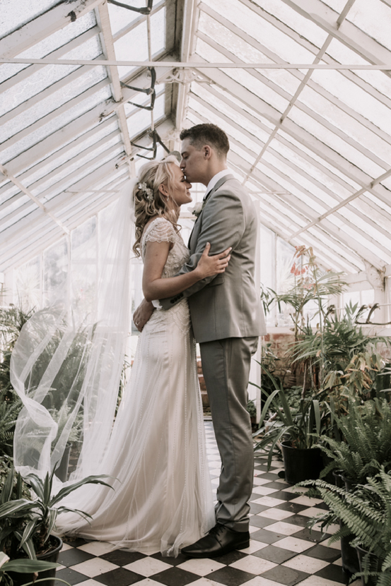 Real bride wearing Ettia an art Deco vintage beaded wedding dress designed by Maggie Sottero